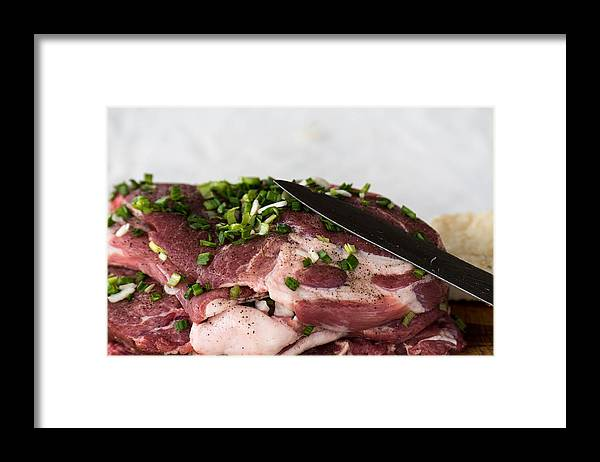 Background Framed Print featuring the photograph Pork meat with green garlik and knife by Adrian Bud