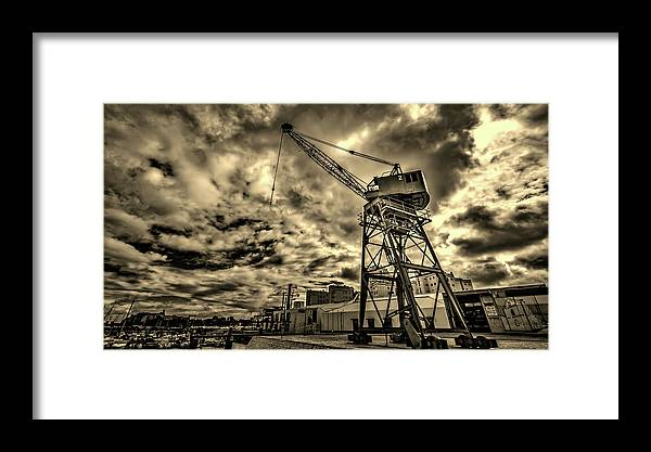 Port Framed Print featuring the photograph Port Crane At Sunset by Ddzphoto