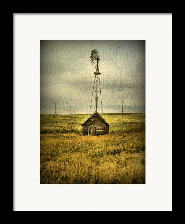 Windmill Framed Print featuring the photograph Prairie Pump by Tingy Wende