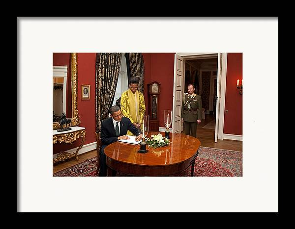 History Framed Print featuring the photograph President Obama And Michelle Obama Sign by Everett