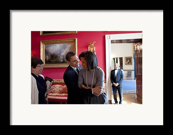 History Framed Print featuring the photograph President Obama Hugs First Lady by Everett