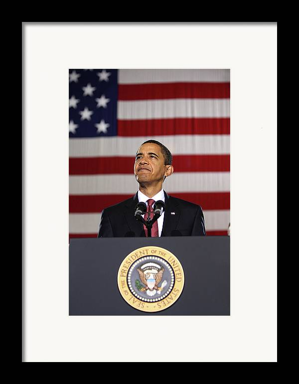 Obama Framed Print featuring the photograph President Obama by War Is Hell Store