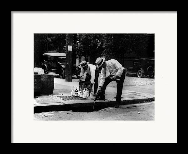 1920s Candid Framed Print featuring the photograph Prohibition, Pouring Whiskey by Everett