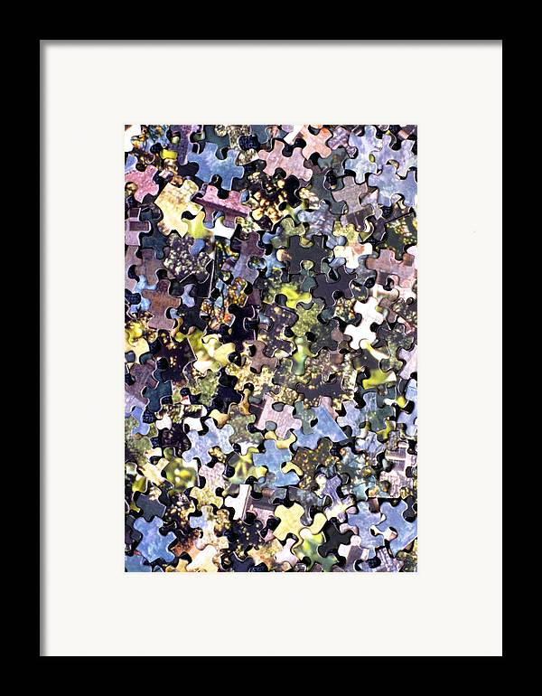Puzzle Framed Print featuring the photograph Puzzle Piece Abstract by Steve Ohlsen