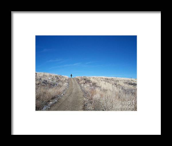 Racing Bike Framed Print featuring the photograph Racing Over The Horizon by Heather Kirk