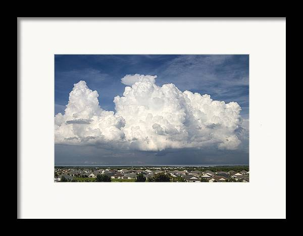 Clouds Framed Print featuring the photograph Rain Clouds Over Lake Apopka by Carl Purcell