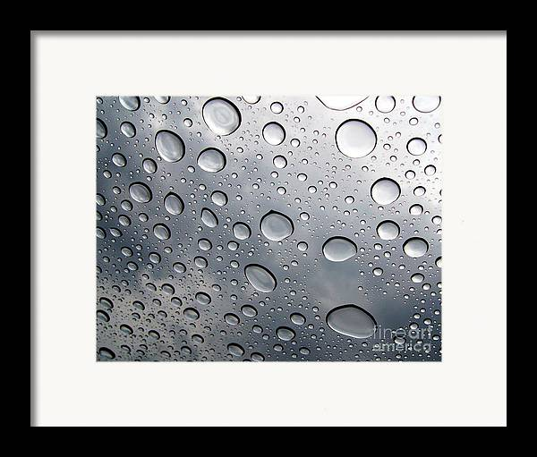 Rain Framed Print featuring the photograph Raindrops by Kenna Westerman