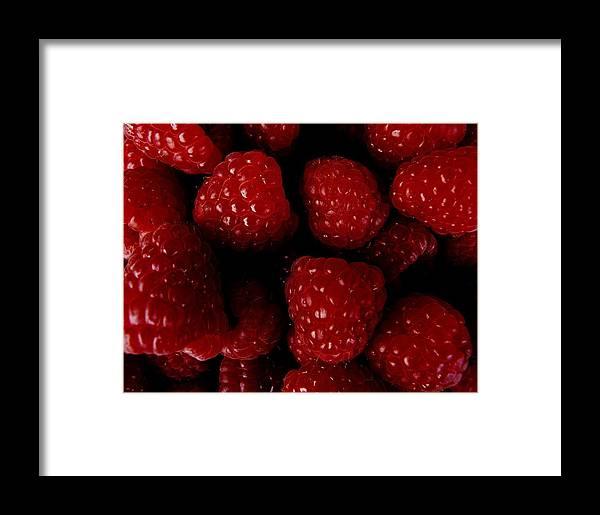Raspberries Framed Print featuring the photograph Raspberries by Valerie Ornstein