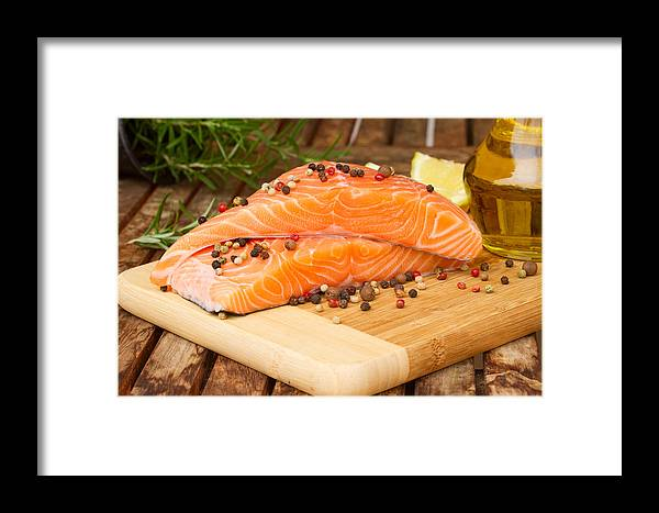 Salmon Framed Print featuring the photograph Raw Salmon Steak by Anastasy Yarmolovich