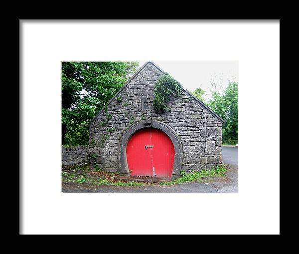 Barn Framed Print featuring the photograph Red Barn Door In Ireland by Jeanette Oberholtzer