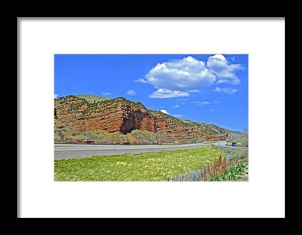 Red Cliffs And White Clouds Over Interstate 80 Rest Stop In Utah Framed Print featuring the photograph Red Cliffs And White Clouds Over Interstate 80 Rest Stop In Utah by Ruth Hager