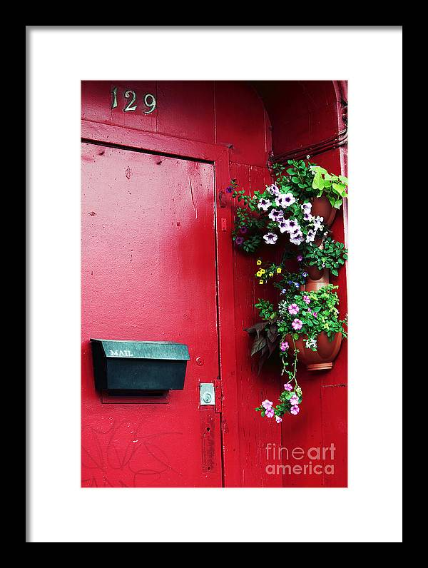 Red Door In Montreal Framed Print featuring the photograph Red Door In Montreal by John Rizzuto