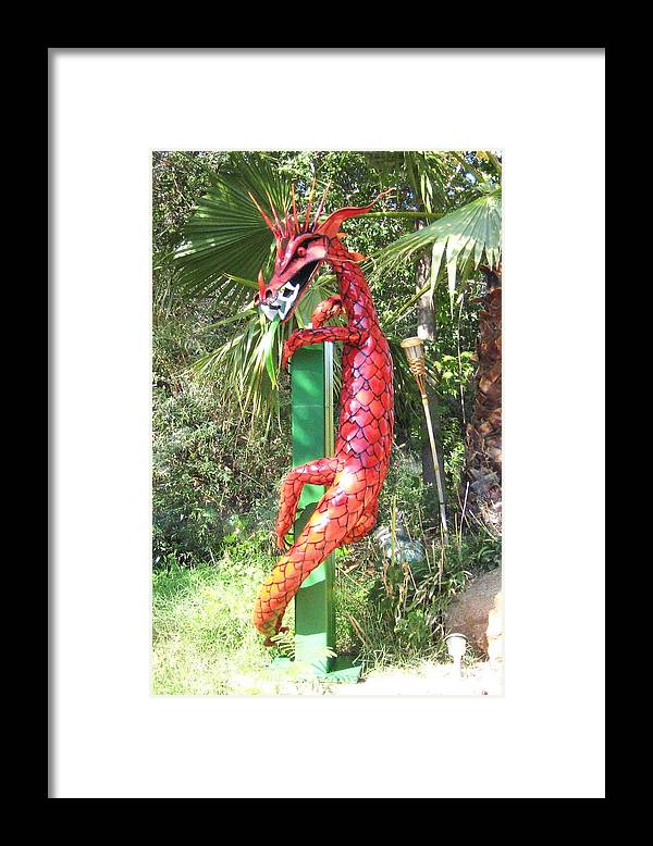 Dragon Framed Print featuring the photograph Red Dragon On Post by Robert Findley