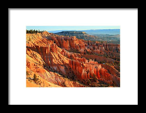 Bryce Framed Print featuring the photograph Red Glow On The Hoodoos Of Bryce Canyon by Pierre Leclerc Photography