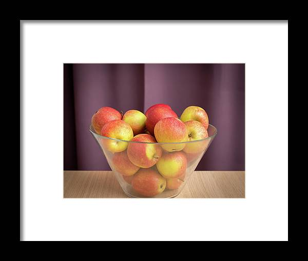 Apple Framed Print featuring the photograph Red Green Apples In A Glass Bowl by Stefan Rotter