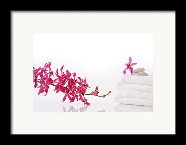 Spa-treatment Framed Print featuring the photograph Red Orchid With Towel by Atiketta Sangasaeng
