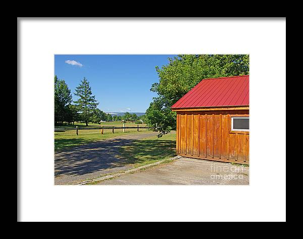 Red Framed Print featuring the photograph Red Roof by Zalman Latzkovich