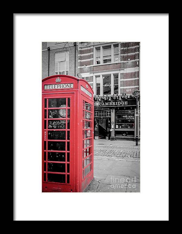 Red Framed Print featuring the photograph Red Telephone Box by Arild Lilleboe