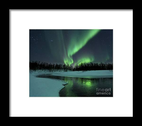 Green Framed Print featuring the photograph Reflected Aurora Over A Frozen Laksa by Arild Heitmann