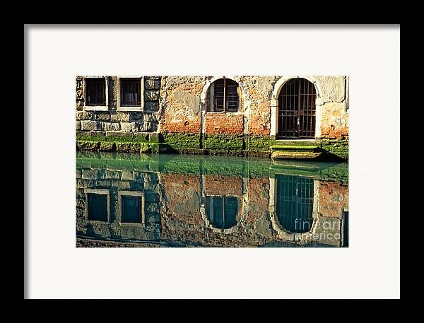 Venice Framed Print featuring the photograph Reflection On Canal In Venice by Michael Henderson
