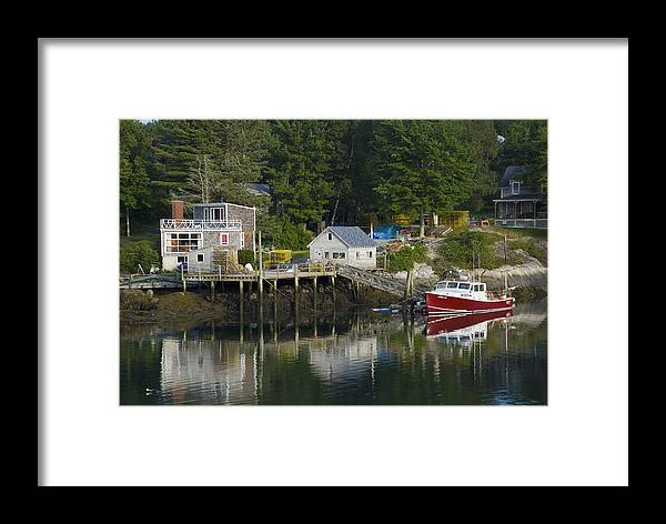 Coastal Framed Print featuring the photograph Reflections Of A Lobster Boat Dock And Traps by Mark Emmerson
