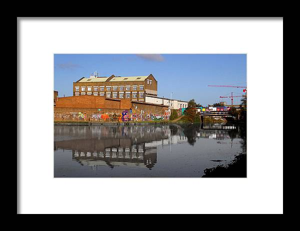 Jez C Self Framed Print featuring the photograph Reflective Canal by Jez C Self
