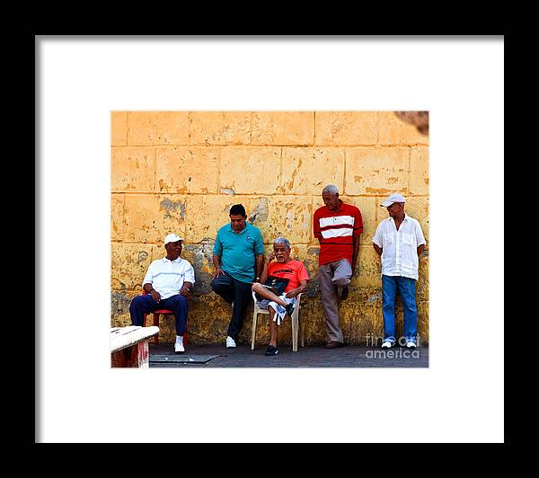 Senior Framed Print featuring the photograph Retired Men And Yellow Wall Cartegena by Thomas Marchessault