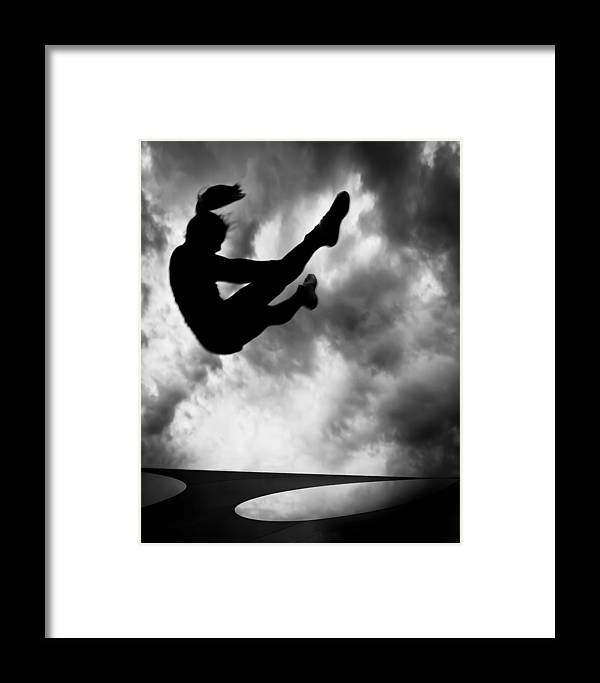Adventure Framed Print featuring the photograph Returning To Earth by Bob Orsillo