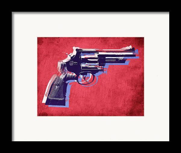 Revolver Framed Print featuring the digital art Revolver On Red by Michael Tompsett