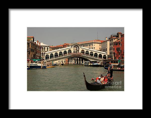 Venice Framed Print featuring the photograph Rialto Bridge In Venice With Gondola by Michael Henderson