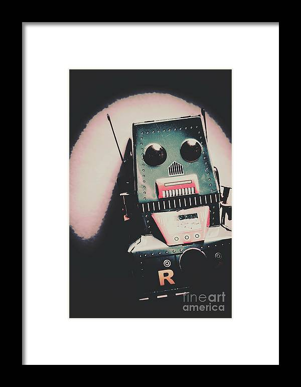 Robot Framed Print featuring the photograph Robotic Mech Under Vintage Spotlight by Jorgo Photography - Wall Art Gallery