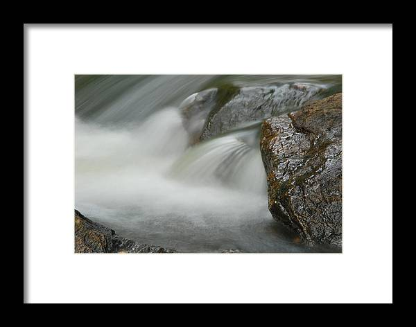 Rock Framed Print featuring the photograph Rock-n-water by John Roncinske