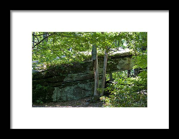 Rocks Framed Print featuring the photograph Rock Tunnel by Darlene Bell