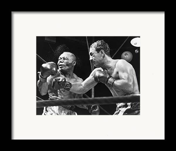 History Framed Print featuring the photograph Rocky Marciano Landing A Punch by Everett