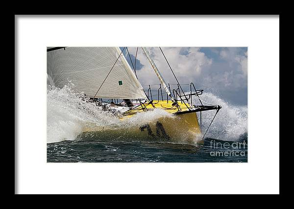 Sailboat Framed Print featuring the photograph Sailboat Le Pingouin Open 60 Charging by Dustin K Ryan