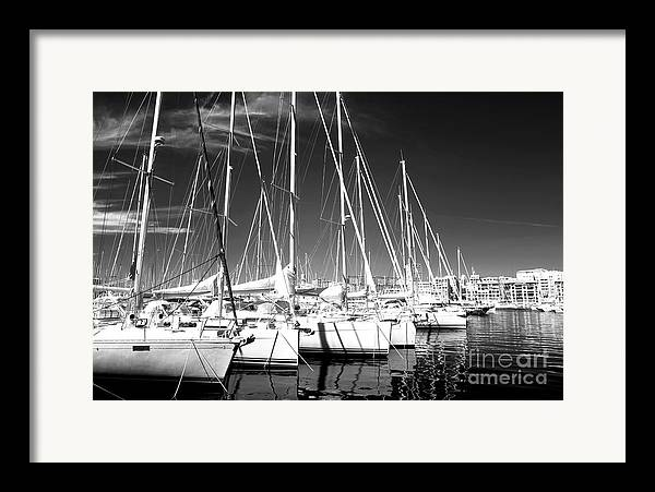 Sailboats Docked Framed Print featuring the photograph Sailboats Docked by John Rizzuto