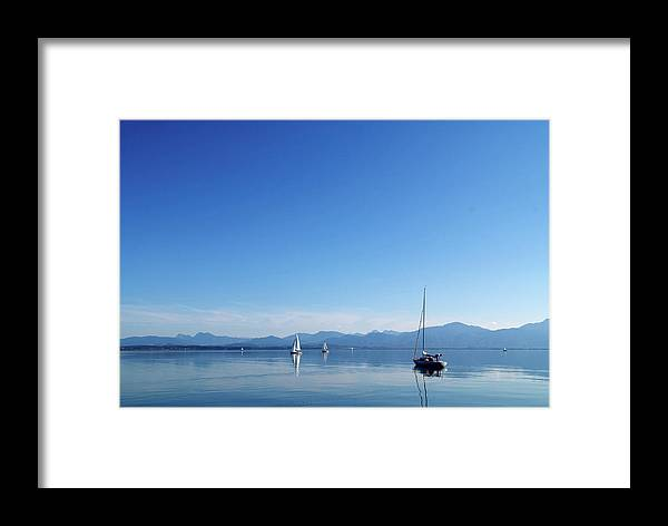 Bay Framed Print featuring the photograph Sailing Boats In Chiemsee Lake In Germany by Jirawat Cheepsumol