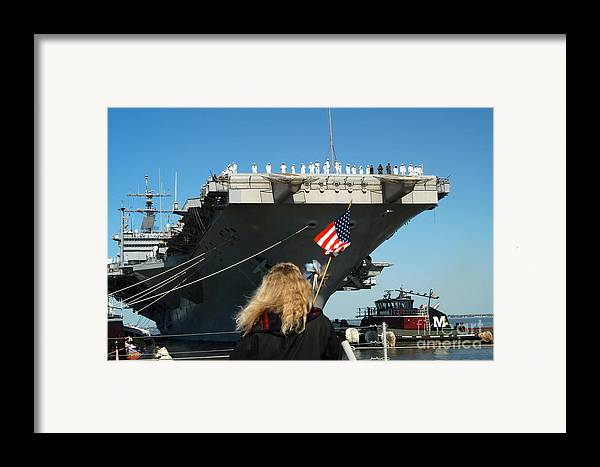 Color Image Framed Print featuring the photograph Sailors Aboard Aircraft Carrier Uss by Stocktrek Images