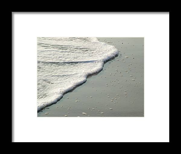 Sand Framed Print featuring the photograph Sand And Foam by John Loyd Rushing