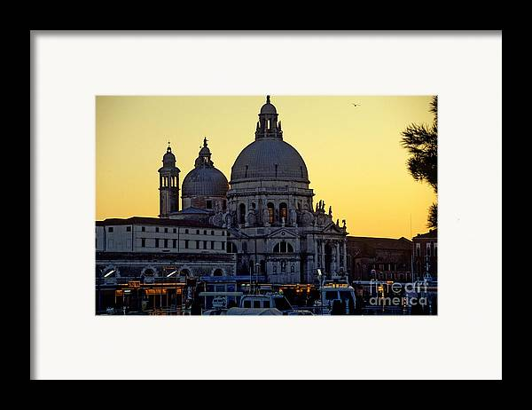 Venice Framed Print featuring the photograph Santa Maria Della Salute On Grand Canal In Venice Against The Evening Sky by Michael Henderson