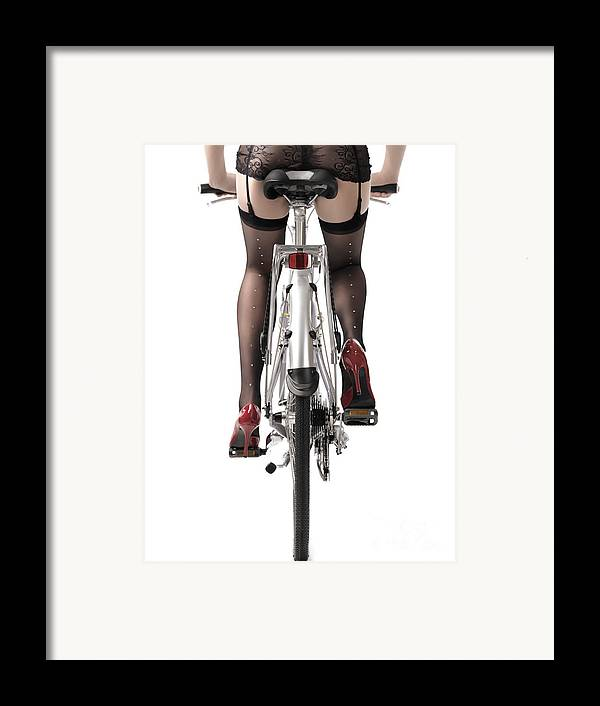 Legs Framed Print featuring the photograph Sexy Woman Riding A Bike by Oleksiy Maksymenko