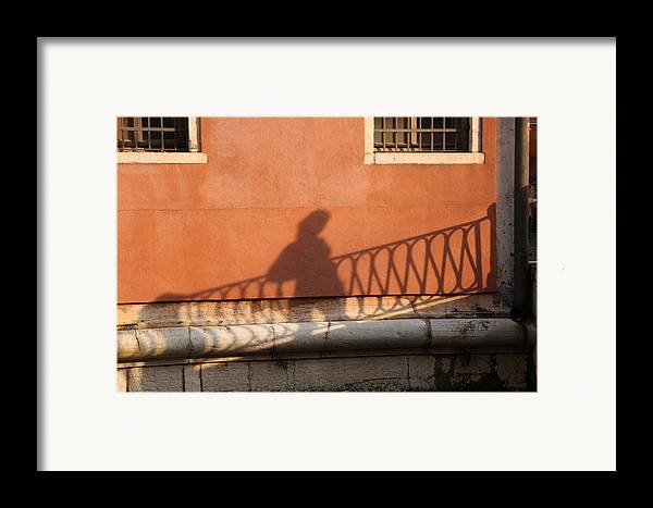 Venice Framed Print featuring the photograph Shadow Of A Person Crossing The Shadow Of A Bridge In Venice by Michael Henderson