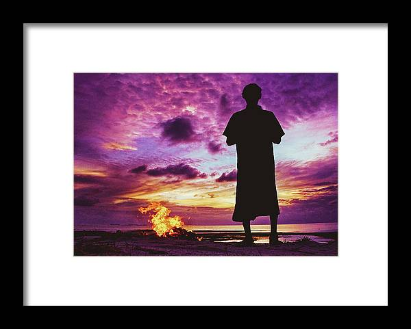 Alone Framed Print featuring the photograph Silhouette Of A Local Man Standing By The Bonfire On The Beach In Maldives During Dramatic Sunset by Srdjan Kirtic