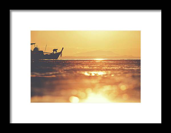 Background Framed Print featuring the photograph Silhouette Of A Thai Fisherman Wooden Boat Longtail During Beautiful Sunrise by Srdjan Kirtic