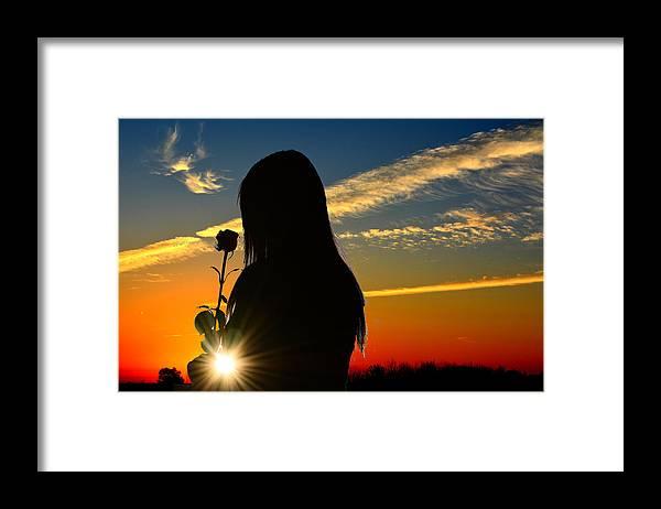 Silhouette Of Girl Holding Rose In The Sunset Framed Print By Reva Steenbergen