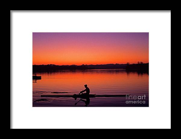 Motion Framed Print featuring the photograph Silhouetted Man Rowing by Jim Corwin