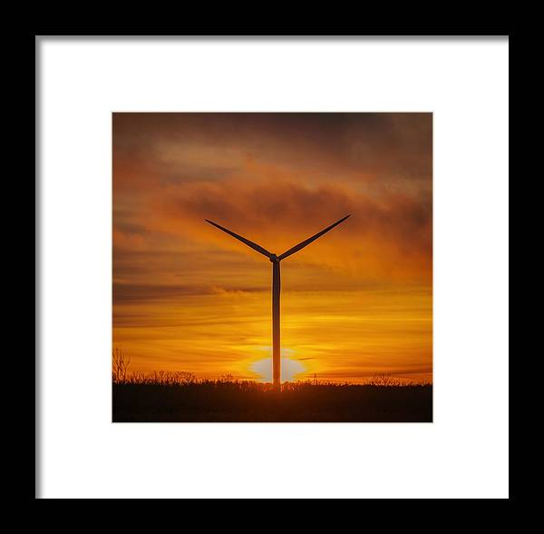 Wind Framed Print featuring the pyrography Silhouettes Of Wind Turbines With A Beautiful Sunset by Maksim Kozlov