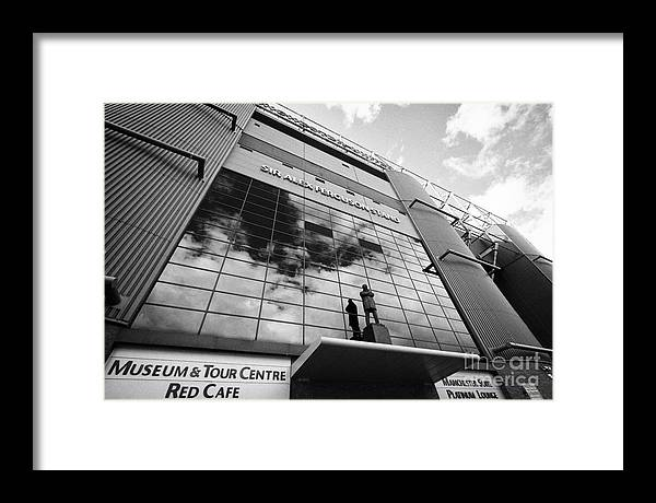 Manchester Framed Print featuring the photograph sir alex ferguson stand Manchester united old trafford stadium uk by Joe Fox