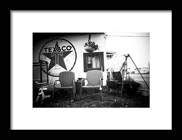 Texaco Framed Print featuring the photograph Sitting at the Texaco black and white by Toni Hopper