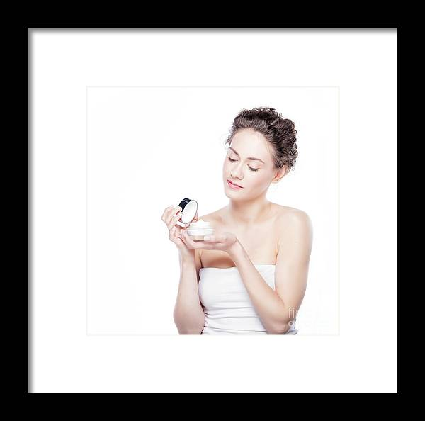 Skincare Framed Print featuring the photograph Skin Care. Young Woman Opening A Creme Jar by Michal Bednarek